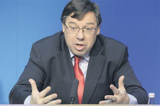 Taoiseach Brian Cowen pictured yesterday detailing the €85bn EU/IMF bailout at Government Buildings in Dublin. Photo: PA
