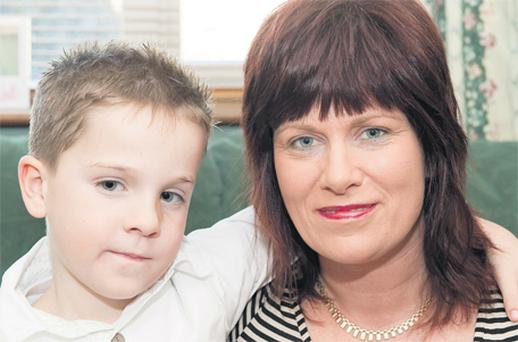 Catherine Manning and her son Oran, who had a stroke last year, pictured in their home in Masseytown, Macroom, Co Cork. Oran will receive the 'Children's Bravery' prize at the National Stroke Awards in Dublin's Mansion House today