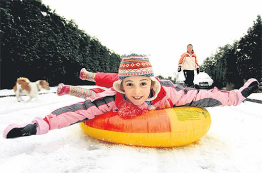 We may be in the grip of an economic crisis and a severe cold snap, but as Garry O'Neill's picture shows,we can still look on the brightside – which is what Sadhbh Murphy did yesterday as she enjoyed snow sliding in Arklow, Co Wicklow