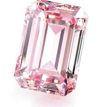 A rare pink diamond, knows as the Perfect Pink, has been sold at auction for a record 14.86 million pounds