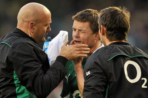 Brian O'Driscoll receives medical attention from team doctor Dr. Eanna Falvey before being substituted during Sunday's game against Argentina.