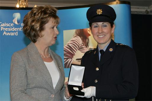 President Mary McAleese presenting Garda Breda Smyth with her gold medal at Dublin Castle yesterday