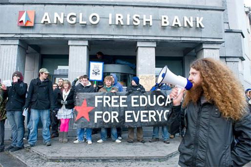 Third level students holding a protest against the €85bn IMF/ECB bailout outside the Anglo Irish Bank branch on Foster Street in Galway yesterday