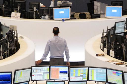 A trader at his desk at Frankfurt Stock Exchange yesterday