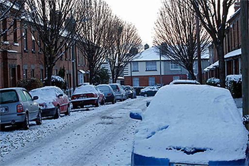 Snow covered cars at Susanville Ave today. Photo: Colin O'Riordan