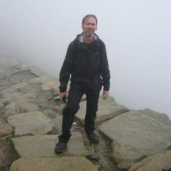 Status Quo drummer Matt Letley poses near the summit of mount Snowdon