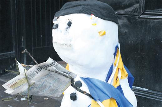 A snowman studies the racing form outside Aggie Madden's pub in Loughrea, Co Galway, yesterday