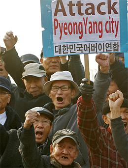 North Korean defectors and anti-North Korea activists protest during a rally outside Seoul, yesterday as pressure grows for retaliation over the North's missile attacks