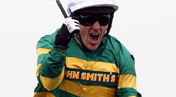 Tony McCoy celebrates winning the John Smith's Grand National on Don't Push It in 2010