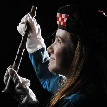 Grace Welden, distant relative of Iain Dall MacKay, holds the oldest known Highland bagpipe chanter