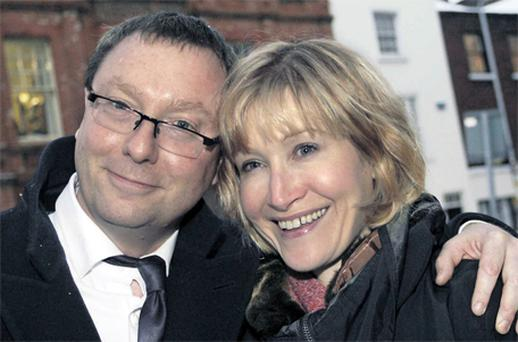 UCC lecturer Dr Dylan Evans (43) and his fiancee Louise Burgoyne outside the High Court in Dublin yesterday