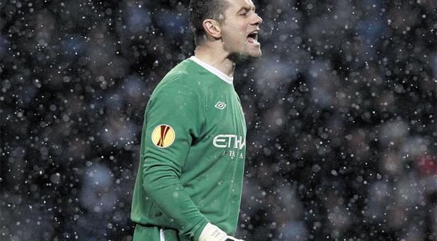 Shay Given barks out the orders to his Manchester City defence during last night's Europa League tie at Eastlands. Photo: Reuters