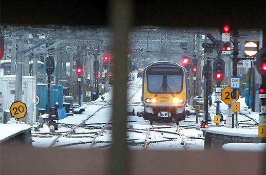 A train arrives in the snow at Connolly Station