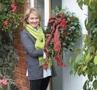 Jenny's homemade wreath for the door which she made using greenery and pinecones she gathered for free