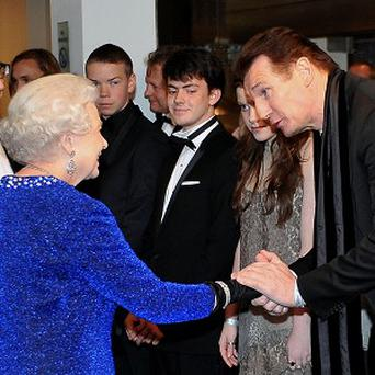 The Queen meets Liam Neeson at the Royal premiere of The Chronicles of Narnia: The Voyage of the Dawn Treader