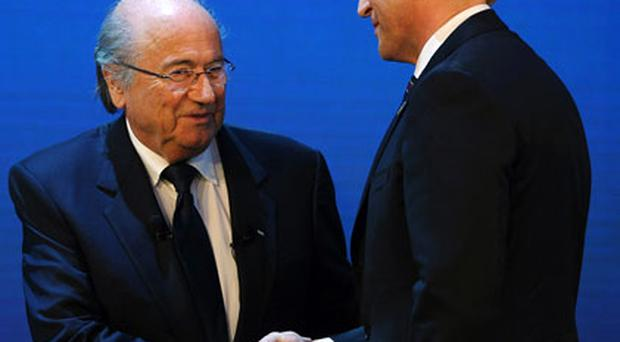 FIFA president Sepp Blatter congratulates Russian Deputy Prime Minister Igor Shuvalov after the announcement that Russia will host the World Cup in 2018. Photo: Getty Images