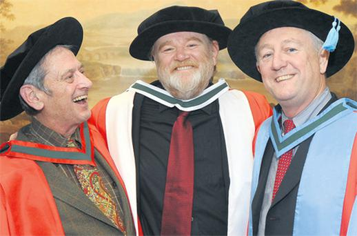 From left: Dr Garrett O'Connor, Brendan Gleeson and Pro Richard Milner, all of whom received honorary degrees from the National University of Ireland yesterday. Photo: Damien Eagers