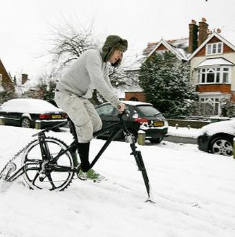 Yannick Read from the Environmental Transport Association rides a snow-bike