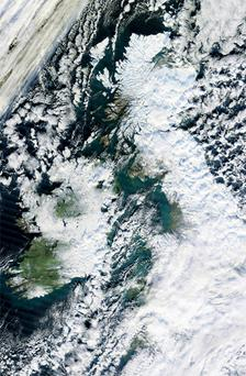 A satellite image of a snow covering Ireland and Britain taken from a NASA satellite named Terra yesterday