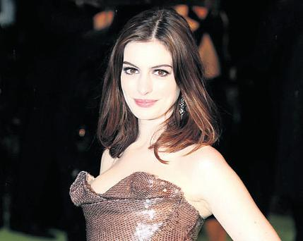 Anne Hathaway is hosting the Oscars this year