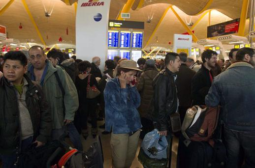 STRANDED: Passengers at Barajas Airport in Madrid were caught in the 'state of alarm' that followed a wildcat strike by air traffic controllers on Friday. Photo: Paul White