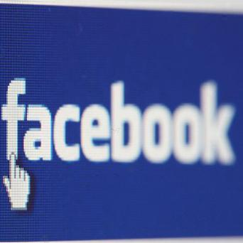 A total of 72 per cent of adults check status updates on Facebook before they go to bed, figures show
