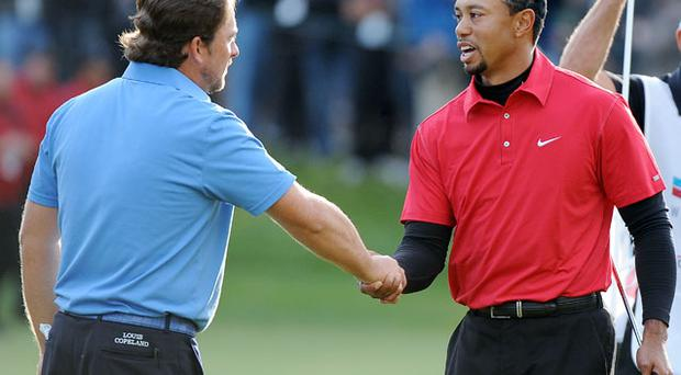 Tiger Woods and Graeme McDowell played in the same group during yesterday's final round of the Chevron World Championship, a title which the Portrush ace won in a play-off. Photo: Getty Images