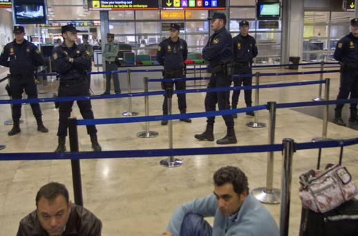 Spanish national police guard the security control entrance at Barajas Airport in Madrid during the air strike. Photo: AP/PAUL WHITE