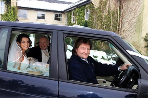 Former Ireland rugby player Shane Byrne helps bride Catriona Walker and her dad Thomas get to the church on time