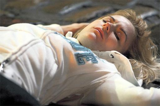 Becky McDonald lies motionless on the cobbles after the accident on 'Coronation Street'