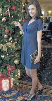 A model shows off the cut-price Kate Middleton look. The blue dress is flying off the shelves as consumers want to look their best this festive season, without splashing too much cash.