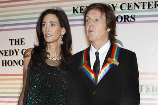 Nancy Shevell, left, and Paul McCartney pose on the red carpet at the Kennedy Centre Honours, in Washington. Photo: AP