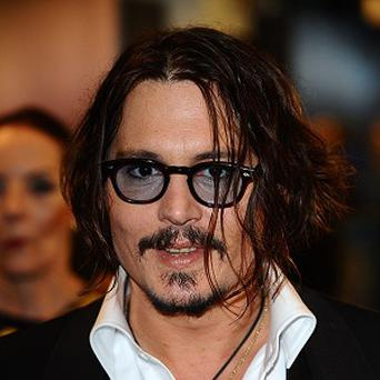 Johnny Depp thinks Brad Pitt would be good as the Lone Ranger