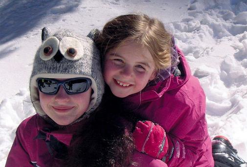 ALL SMILES: It's impossible for kids to get bored with the activity on the slopes, and once they're tired out, parents can get some peace, ready for more icy action next day. Eilis O'Hanlon's children Emer and Molly found it all a scream — in a good way