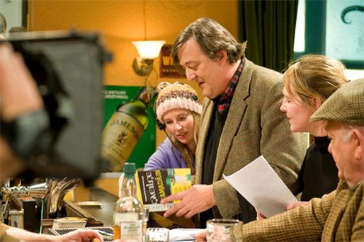 Stephen Fry preparing for his 'Ros na Run' scene with art director Sarah Leonard , director Marion Ni Loingsigh and actor Diarmuid Mac An Adhaistair