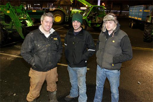 Gavin Satchwell, Dave Robinson and James Hinde after clearing snow from the Nutgrove Shopping Centre carpark in Dublin