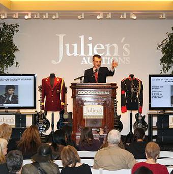 The auction of Michael Jackson's stage clothes sparked furious bidding(AP)