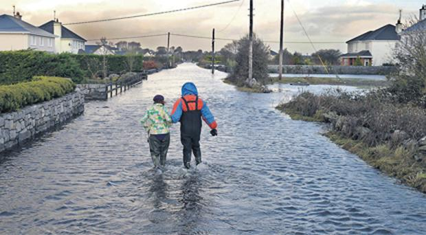 Mary and Michael Keenan return to their house last year to see what damage was caused by floods in Caherlea, Claregalway, Co Galway