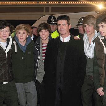 Simon Cowell and X Factor contestants One Direction arrive at Queen Square, Wolverhampton