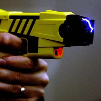 A firearms officer is being investigated after losing a Taser when he drove off with it on the roof of his car
