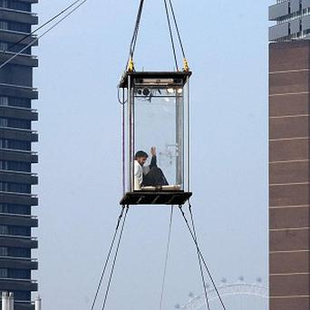 American Illusionist David Blaine lived in a perspex box near Tower Bridge, London, for 44 days