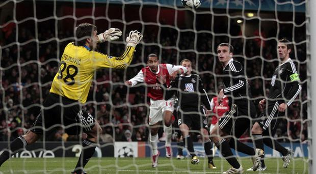 Theo Walcott volleys home Arsenal's second goal against Partizan Belgrade last night
