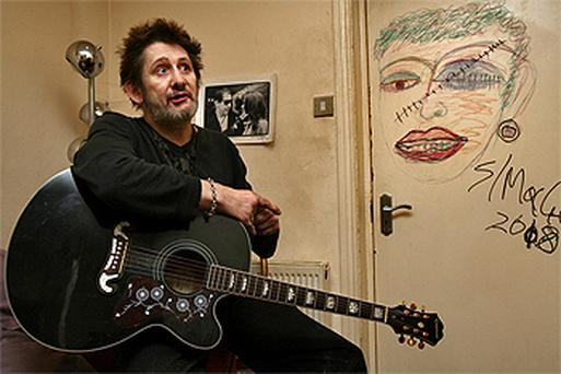 Singer Shane MacGowan with the piece of art he has donated to the ISPCC for auction