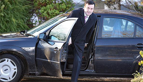 Finance Minister Brian Lenihan arriving at the RTE studios in Dublin yesterday for an appearance on 'The Pat Kenny Show'