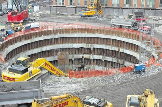 Work in 2008 on the foundation hole for the Chicago Spire apartment building then under construction in Chicago,Illinois.Developer Garrett Kelleher hoped a weak dollar and the cachet of living in the world's tallest condominium tower would bolster the project