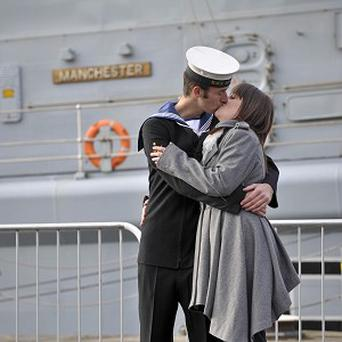 Kayleigh Williams, 19, and Able Seaman Specialist Ben Pritchett, 21, share a moment after they got engaged