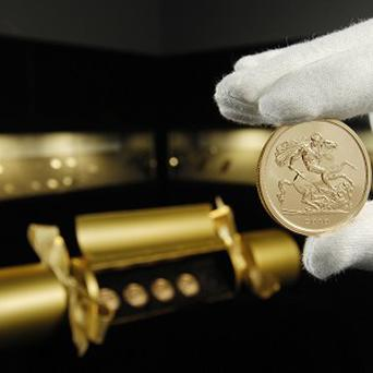 One of the sovereigns from the Royal Mint's Christmas cracker containing five 22 carat gold sovereigns