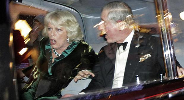 Prince Charles and Camilla, Duchess of Cornwall react as their car is attacked. Photo: AP