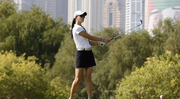 Michelle Wie plays her second shot on the eighth hole during the second round of the Dubai Ladies Masters European Tour. The American finished on one-under after yesterday's 72. Photo: Reuters