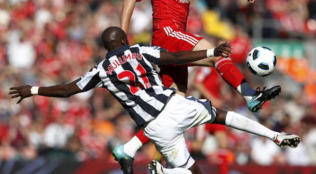 Youssouf Mulumbu with a strong tackle. Photo: Reuters